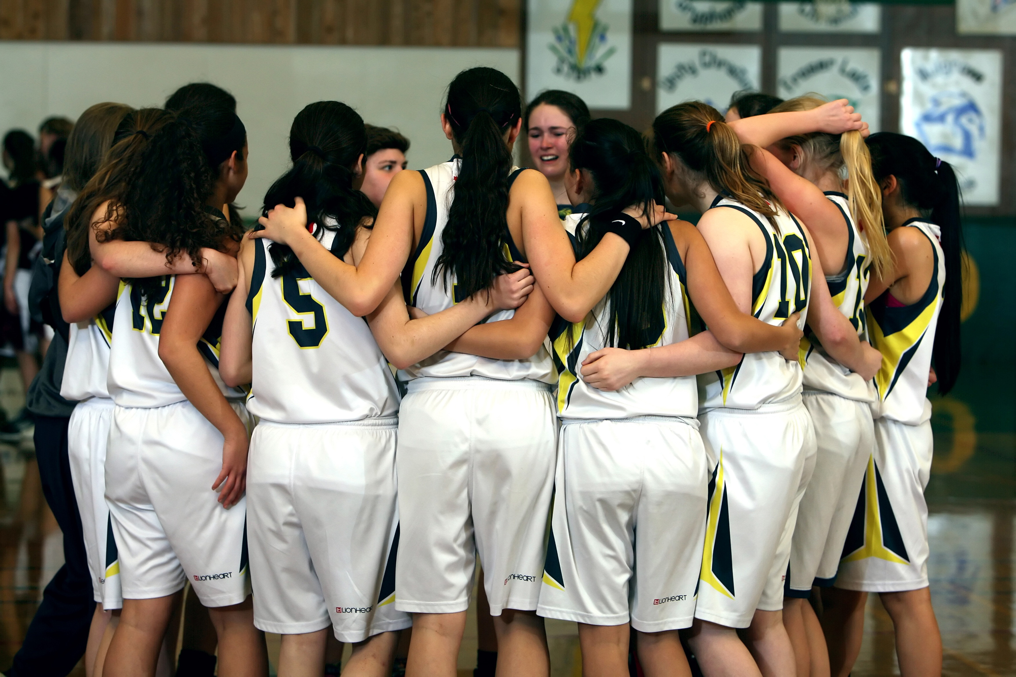 Girls Basketball Team giving each other moral support