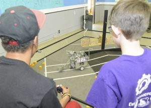 Odyssey of the Mind Team using its Robot