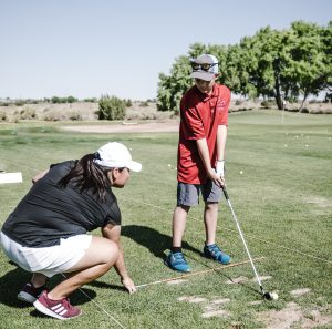 Golf booostr club support helping with extra driving range time and instruction.