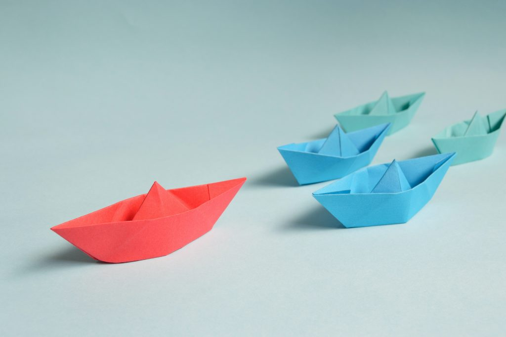 Paper boats showing leadership concept