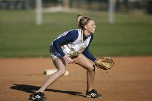 Softball infielder in ready pose during game