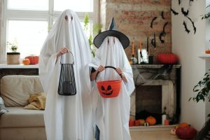 Halloween ghosts and their trick or treat buckets