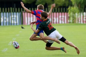 Tackle in progress during a rugby match.