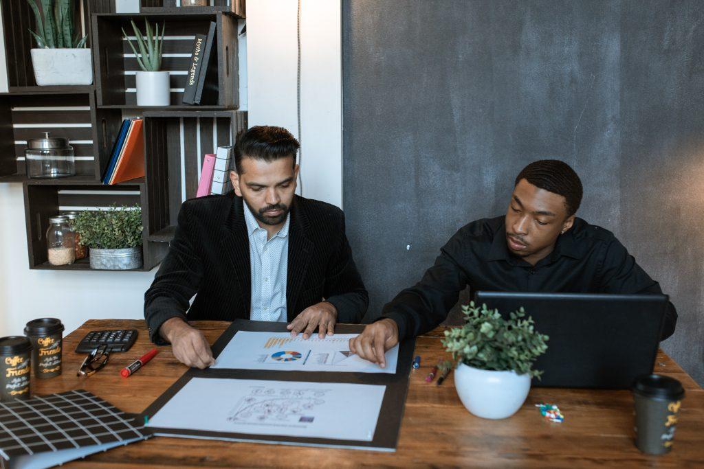 Volunteers creating a simple booster club marketing plan